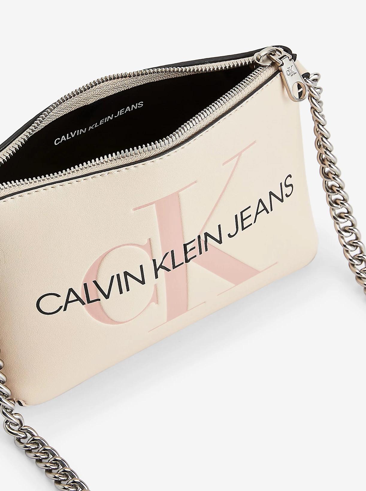 Calvin Klein krem crossbody torbica